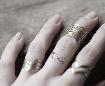 mini infinity finger tattoo
