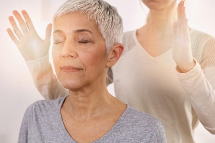 Women receiving a Reiki attunement