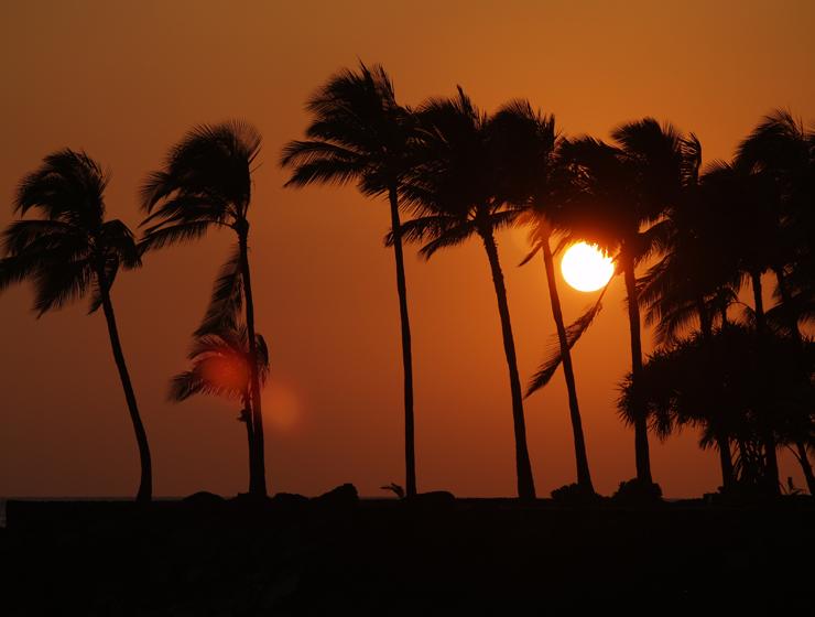 A Vog-Tinted Sunset from the Kailua Pier, Kailua Kona, Hawaii Photo by Donnie MacGowan