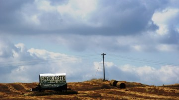 Sneak Creek - imaginative sign! (old covered wagon)