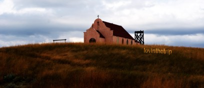 an old Catholic church in the middle of nowhere