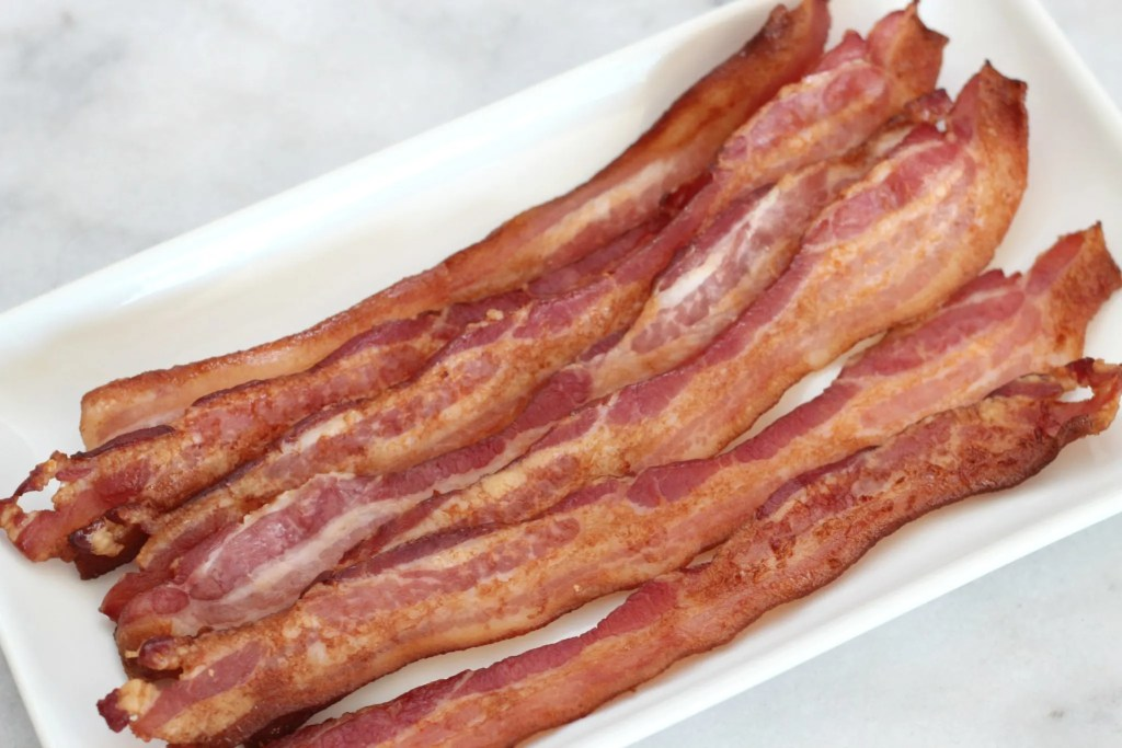 Once you use this method to bake your bacon, you'll never prepare it another way again! Easy perfect oven baked bacon! #cookingbasics #bacon #lowcarb #keto