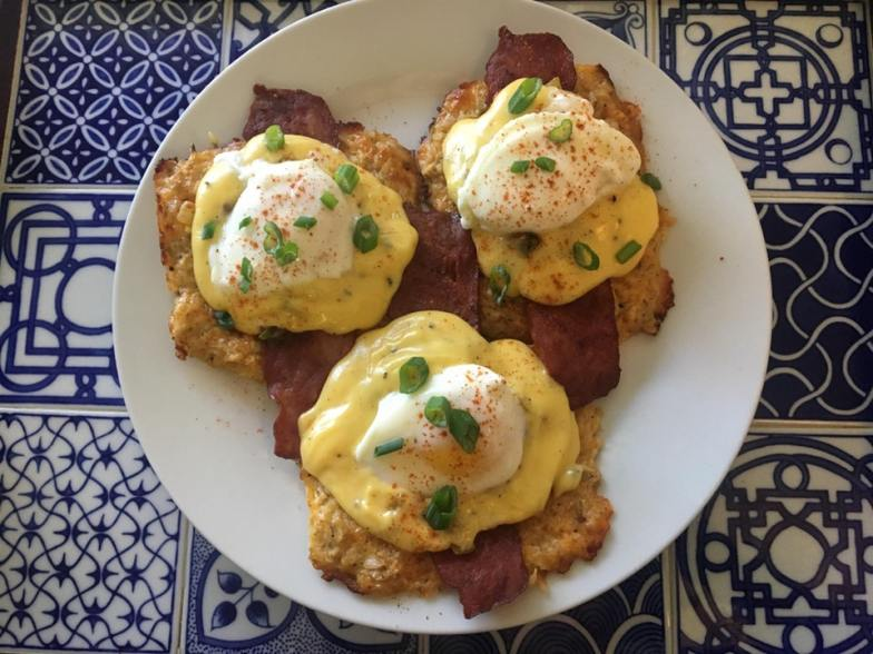Eggs Benedict with homemade hollandaise sauce, bacon, and cheddar cauliflower hash browns