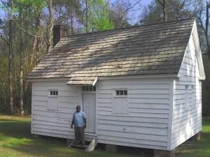 Joe McGill at Door of Slave Cabin