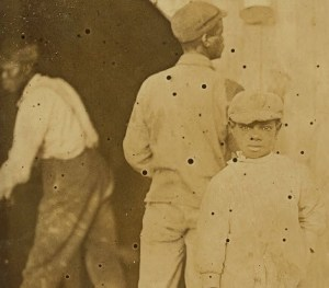 One of the youngest shuckers at McClellansville Canning Company. All negroes and none extremely young. Location McClellansville, South Carolina. LOC 01025v Detail