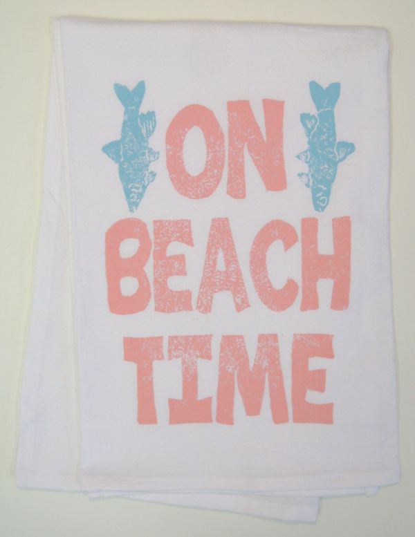 on beach time towel