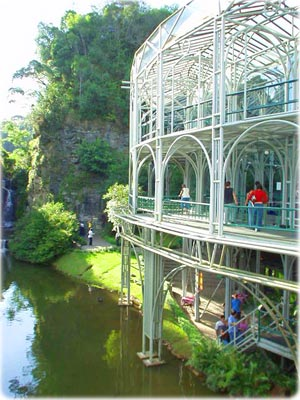 Opera de Arame, Curitiba's opera house surrounded by a lush, green environment.