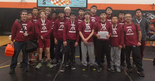 Lowell wrestlers showing off the medals won at the Peninsula JV Invitational