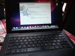 John Hatchett's black MacBook