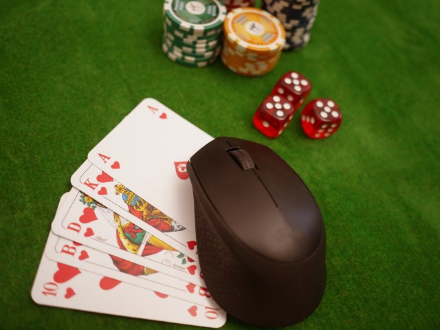 Poker cards, chips, dice, and mouse