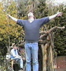 Matt of The Gits stands with arms outstretched as if crucified