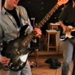 Ben wearing large rimmed glasses whilst playing bass having a very vague resembalance to producer, singer and bass player Trevor Horn