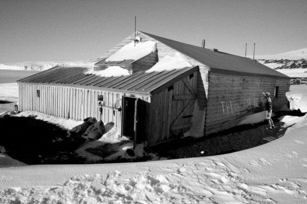 Ben writing 'The Gits' on Scott's Hut in Antartica