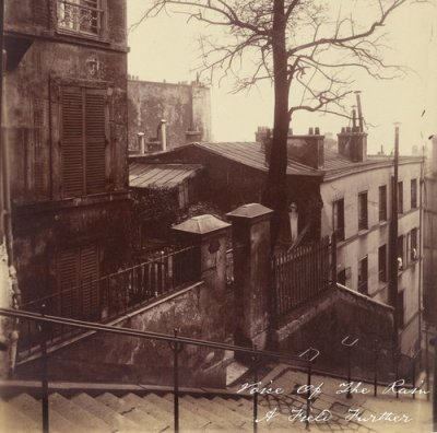 Front cover of A Field Further which is a photograph taken by Eugène Atget in 1921 of the staircase at Montmartre which consists of several wide flights with a hand rail up the centre and houses either side.