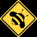 Road side information style sign in black on yellow showing a bumble bee