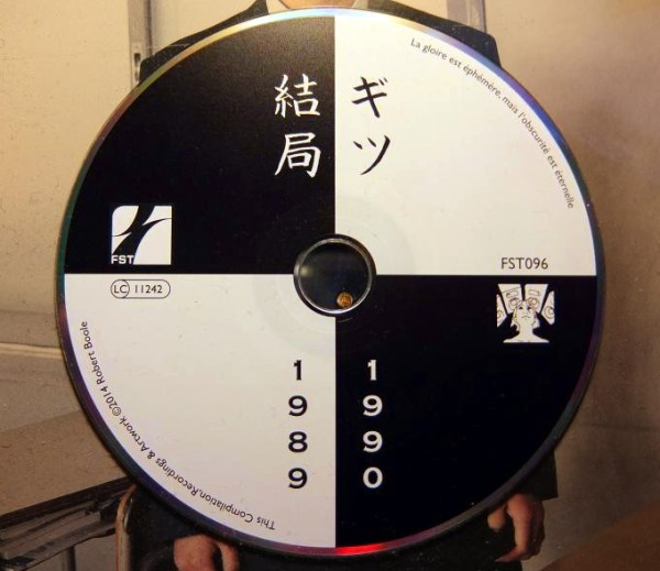 Photograph of the Gits CD showing the dates error - 1989-1990 printed when it should have been 1987-1990
