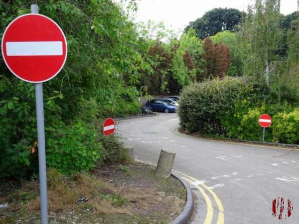 Three closely spaced No Entry signs at Horsham Hospital.