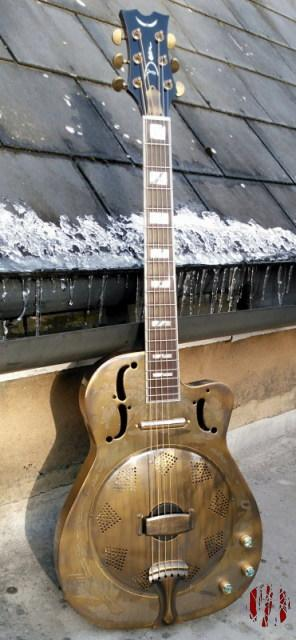 A resonator guitar made of brass coated iron