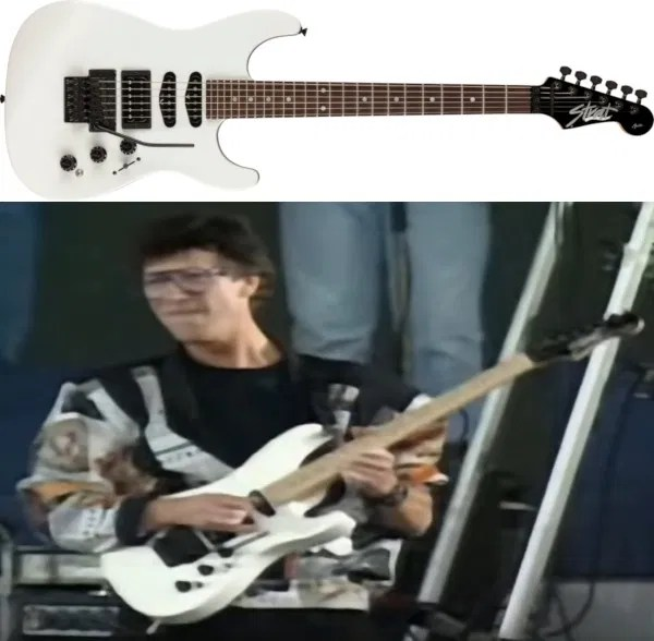 Hank Marvin playing the HM Strat at Knebworth with Cliff Richard in 1990