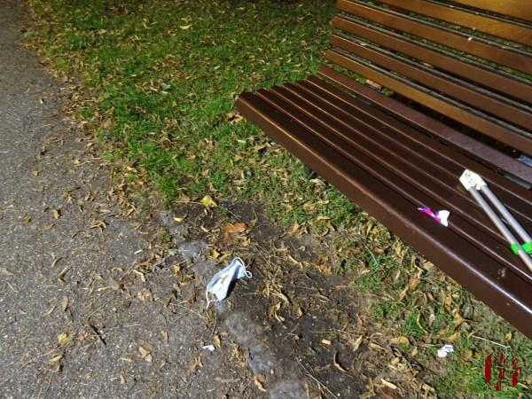 A face mask discard by a bench in Horsham Park seen in the time of Coronavirus Covid-19.
