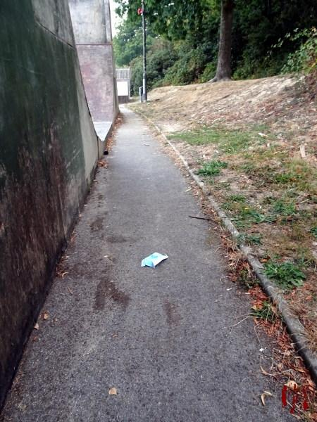 A view of the skate park in Horsham Park seen over a discarded face mask in the time of Coronavirus Covid-19.
