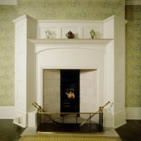 Kettle trestle in fireplace with copper kettle in the ...