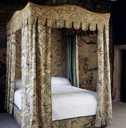 The mahogany bed in the Lawn Room dates from the 19th