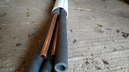 Insulated pipes packed into PVC sheath.