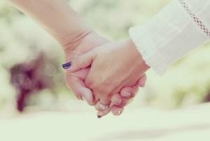 Holding hands offer support