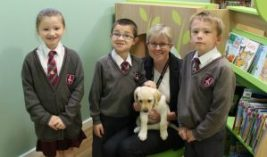 Pupils from Golborne St Thomas's Primary with Head Teacher Mrs Woods and new school therapy dog, Thelma.