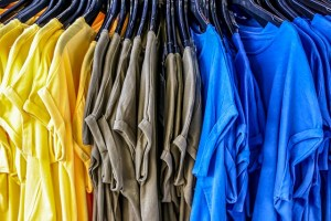 colourful t-shirts hanging on a clothes rail
