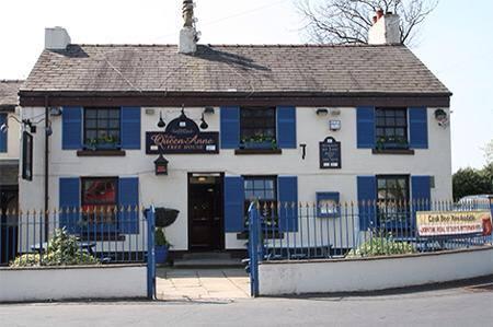 The exterior of The Queen Anne Pub in Golborne