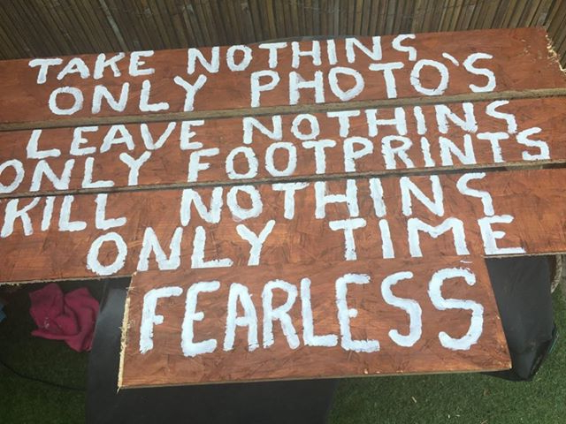 Handmade sign says 'Take nothing only photos, leave nothing only footprints, kill nothing only time - Fearless""