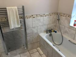 Bathroom installed by Wilson Plumbing and Heating