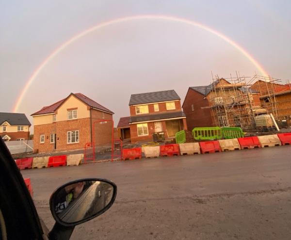 Neil Darbyshire's photo of a rainbow over Rothwells Farm housing development in Golborne