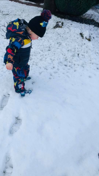 Two year old takes first steps in the snow, taken by Katie Rawlinson