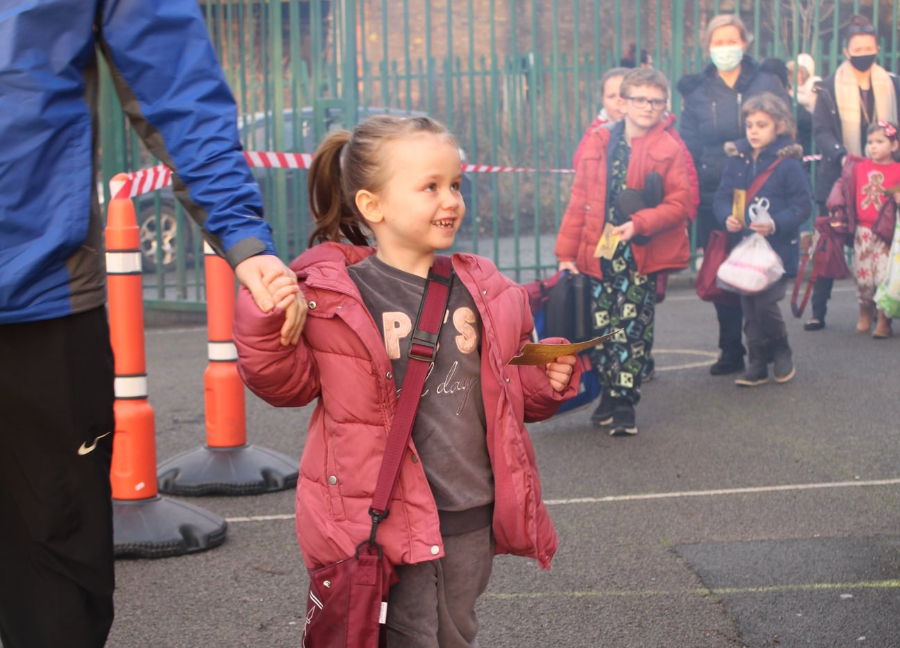 This girl was amazed to arrive at school and find it transformed into a festive wonderland.