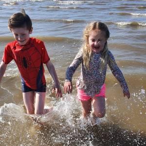 Children splashing in the sea