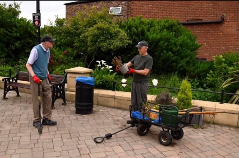 Golborne in Bloom volunteers planting at Peter Kane Square