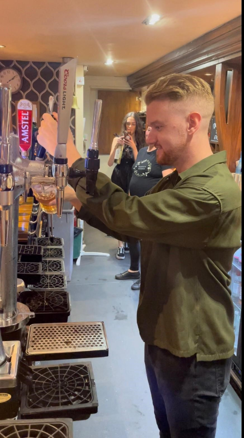 Mikey North, who plays Gary Windass in Coronation Street pulling a pint in a bar