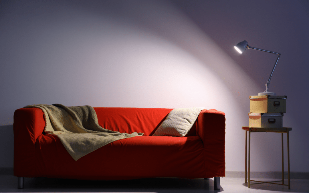 Task light shining on a red couch