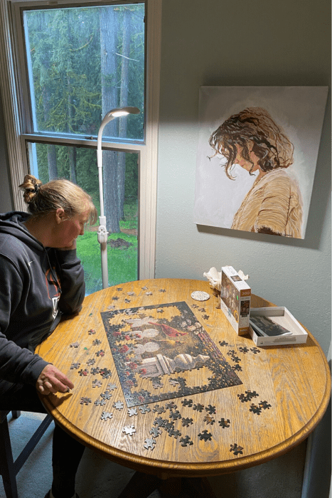 Doing a puzzle with the Stella SKY TWO LED Floor Lamp