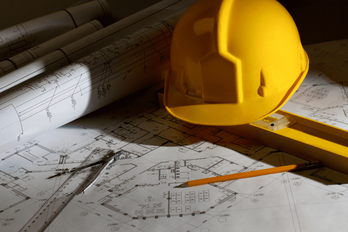 Blueprints, a hard hat and other miscellaneous tools. Bernie McGee uses assistive technology to work in the construction industry with low vision.