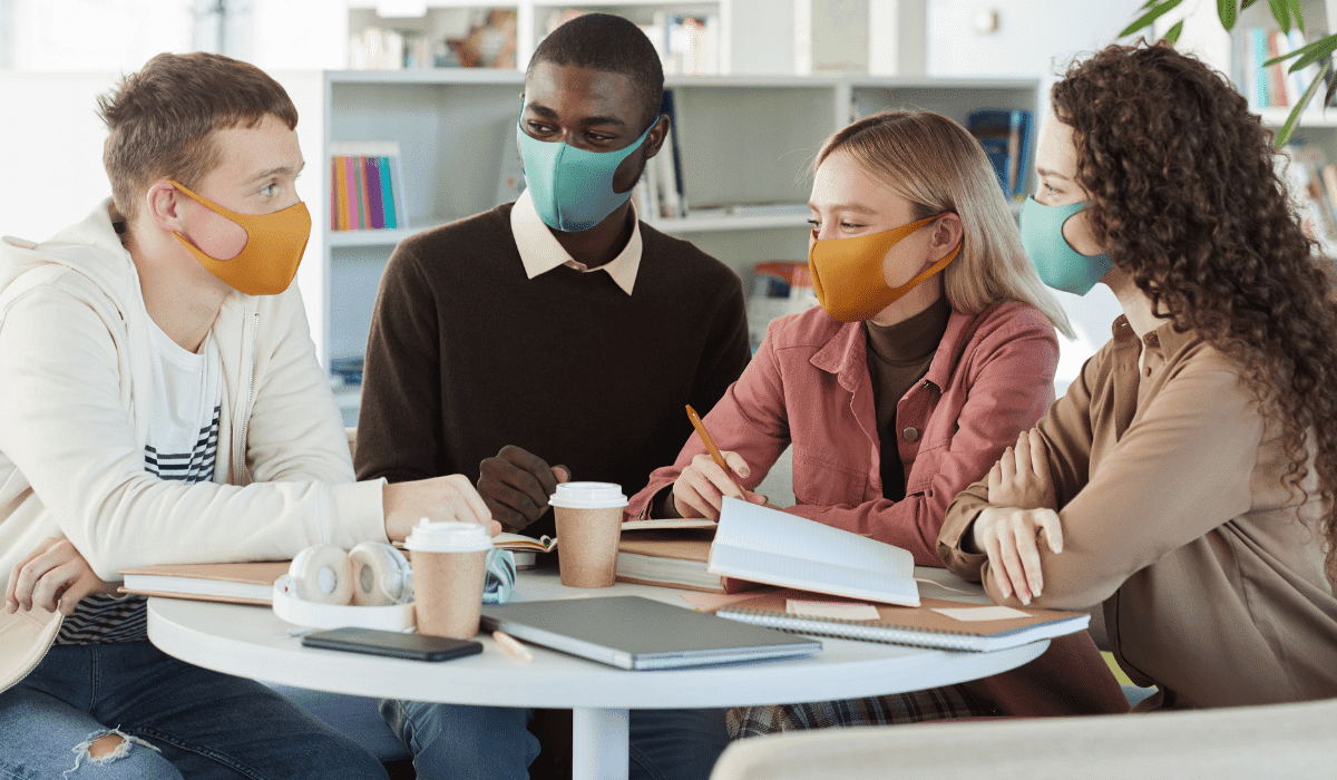 Young people at library wearing masks.