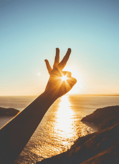 Hand held up toward the sun