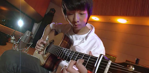 Sungha Jung man in the miror Sungha Jung Cover Michael Jacksons Man In The Mirror Classical Finger Style Guitar. A Kid Chasing His Dreams.