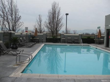 Hyatt Place Dublin pool, looking west. Oakland is on other side of hills in background.