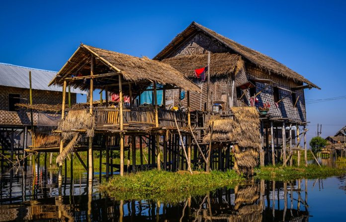 Bamboo-pole stilt house on the water at Inle Lake