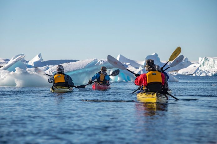 Kayakers in the water in the Antartic
