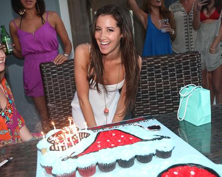 photo of Ashley Tisdale with large birthday cake